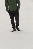 Incomplete figure Elegant Man Walking on Snow Royalty Free Stock Images