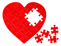 Incomplete jigsaw puzzle in a shape of a heart Royalty Free Stock Photos