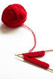 Incomplete knitting project with ball of wool Royalty Free Stock Photo
