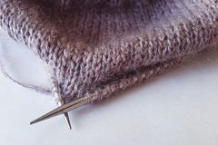 Incomplete knitting project with metal needles close-up.  royalty free stock photo