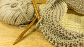 Incomplete knitting project with a woolen ball Royalty Free Stock Photos