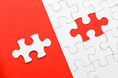 Incomplete puzzle with missing piece. In red color royalty free stock image