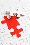 Incomplete puzzle with missing piece. In red color stock image