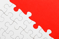 Incomplete puzzle with missing piece. Incomplete puzzle in red color stock photos