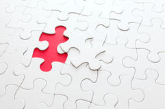 Incomplete puzzle with missing piece. In red color stock photography