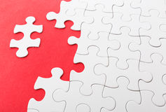 Incomplete puzzle with missing pieces. In red color royalty free stock photography