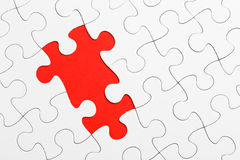 Incomplete puzzle. In red color stock image