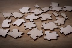 Incomplete puzzles. jigsaw puzzle. On wooden background royalty free stock photo