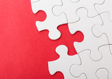 Incompleted white puzzle Royalty Free Stock Photo