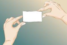 Incompleto ilustrado dos manos que sostienen la tarjeta Fotografía de archivo libre de regalías