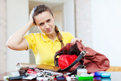 Inconsiderate woman lost something Stock Image