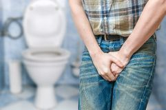 Incontinence concept. Man wants to pee and is holding his bladder
