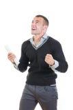 Incoraggiare laureato del maschio emozionante con il diploma Immagine Stock