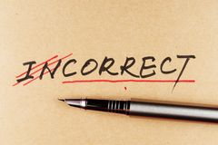 From incorrect to correct. Amending incorrect word and changing it to correct using a pen stock image