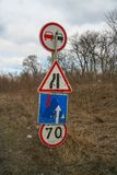 Incorrectly installed traffic signs. On the highway Kharkiv - Simferopol. March 2011 Stock Photos
