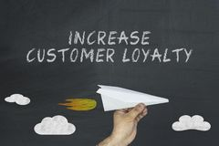 Increase customer loyalty concept on blackboard Stock Image