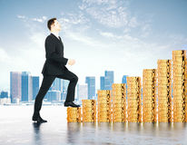 Increase in profits concept with businessman climbs the stairs o Stock Photography