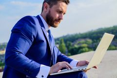 Increase rates online sales tips. Businessman surfing internet or reply emails while sit with laptop outdoors. How get. High reply rates. Internet marketing stock photo