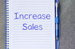 Increase sales write on notebook Royalty Free Stock Photos