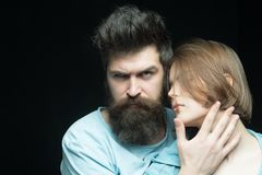 Increase your brutality with growing long beard. Women love bearded brutal and masculine guys. Hipster bearded brutal. Cuddling with sensual girl. She likes his royalty free stock photo