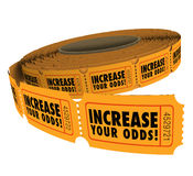 Increase Your Odds Raffle Tickets Roll Improve Chances Winning. Increase Your Odds words on a roll of raffle or lottery tickets, encouraging you to buy more to Stock Photo