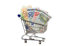 Increased cost of living. Model shopping trolley with  euro banknotes on white background Stock Photo