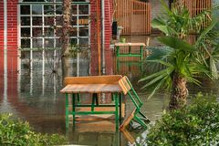 The increased level of water from rains in the front yard house. Concept - bad weather conditions Stock Photography