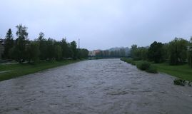 Increased river level in Frydek-Mistek after rainy days. Danger of floods in Moravia lands. Cloudy and brutal rainy day. Floods in. The Czech Republic, in may stock image