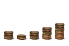Increasing columns of coins II Stock Photo