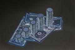 Increasing columns of coins, piles of coins arranged as a graph Stock Photography