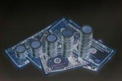 Increasing columns of coins, piles of coins arranged as a graph. Savings, increasing columns of coins, piles of coins arranged as a graph and American dollar Stock Photos
