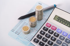 Increasing columns of coins, piles of coins arranged as a graph Stock Image