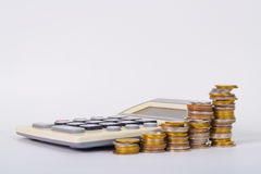 Increasing columns of coins, piles of coins arranged as a graph Royalty Free Stock Image