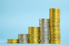 Increasing columns of coins, step of stacks coin with copy space Stock Photo