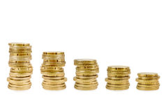 Increasing columns of gold coins over Royalty Free Stock Photography