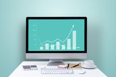 Increasing graph on computer screen. Office desk with increasing graph on computer screen Royalty Free Stock Photos