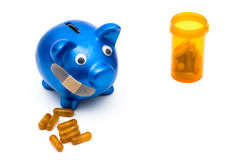 Increasing health care costs. Piggy bank with a bandage over it on a white background, medication costs Stock Images