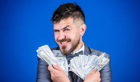 Increasing his cash income. Currency broker with bundle of money. Rich businessman with us dollars banknotes. Bearded. Man holding cash money. Making money with royalty free stock images