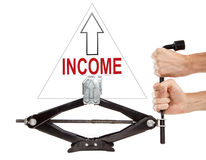 Increasing income. Car jack on white background with arrow up and note Income Royalty Free Stock Photos