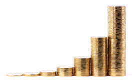 Increasing piles of golden coins Stock Image