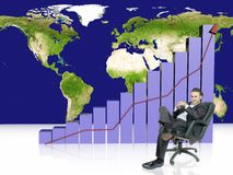 Increasing profits. Businessman is sitting in front of increasing profits graph Royalty Free Stock Photo
