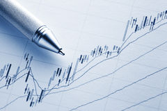 Increasing stock market graph. With pen Stock Photo