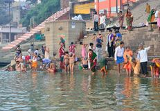 Incrediable India. Indian People Washing and Bathing in the Ganges River in the Morning Stock Photos