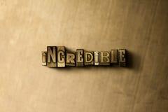 INCREDIBILE - il primo piano dell'annata grungy ha composto la parola sul contesto del metallo immagini stock