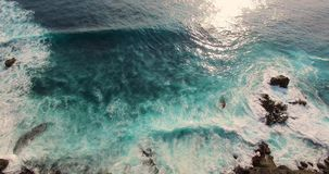Incredible aerial camera lifting from ocean waves and shore to horizon stock video