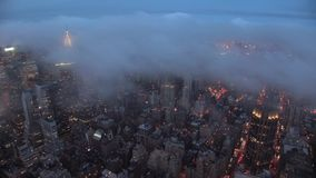 Incredible aerial 4k time lapse panorama on heavy gray rain cloud moving over evening sky modern New Tork city downtown. Incredible aerial 4k time lapse view on stock video footage