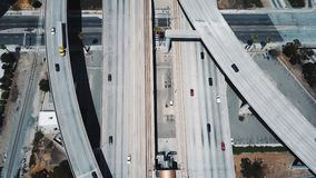Incredible aerial shot of a big freeway intersection in Los Angeles, USA, traffic going fast through many road flyovers. stock video