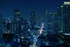 Incredible Aerial View of Cityscape with Skyscrapers of Bangkok Downtown at Night in Dark Blue Color royalty free stock photo