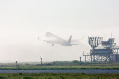 Incredible airplane taking off. In fog royalty free stock images