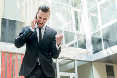 An incredible bargain. Happy businessman celebrates his success. Stock Images